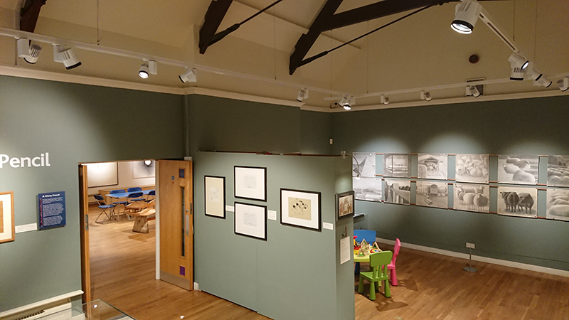 Falmouth art gallery. Installation of adjustable suspended lighting system in the display gallery.